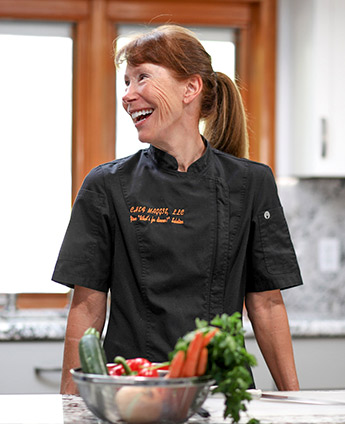 Tucson Personal Chef Maggie preparing a meal for a family